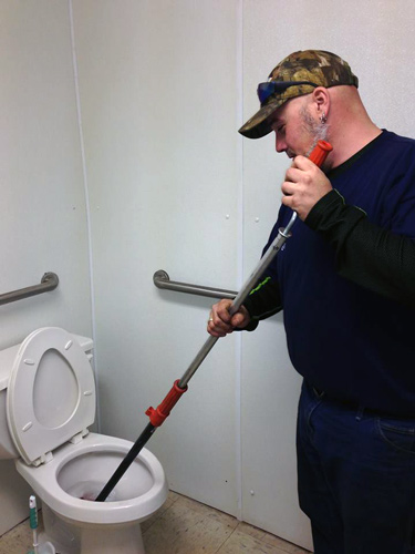 working-on-toilet